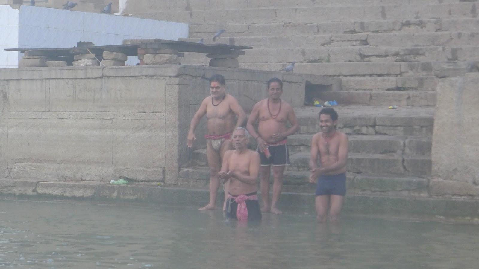 men bathing in the ganges varanasi